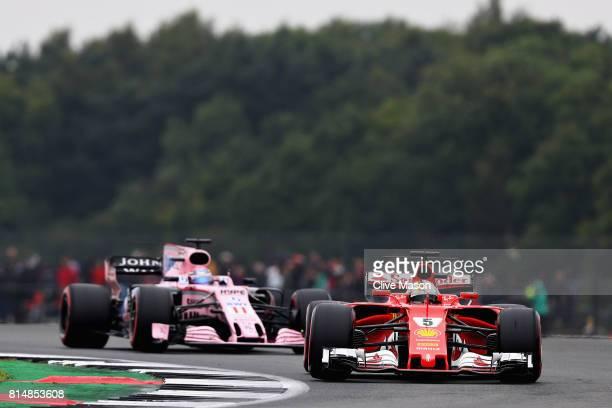 Sebastian Vettel of Germany driving the Scuderia Ferrari SF70H leads Sergio Perez of Mexico driving the Sahara Force India F1 Team VJM10 on track...