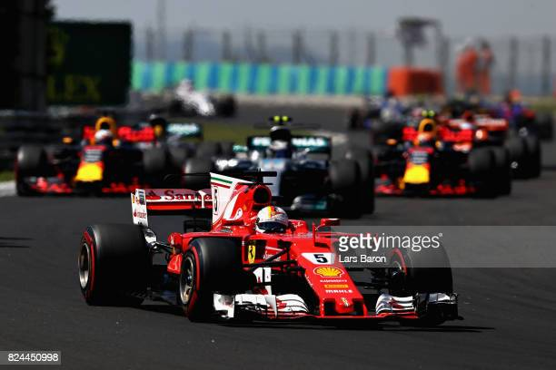 Sebastian Vettel of Germany driving the Scuderia Ferrari SF70H leads the field into the second corner during the Formula One Grand Prix of Hungary at...