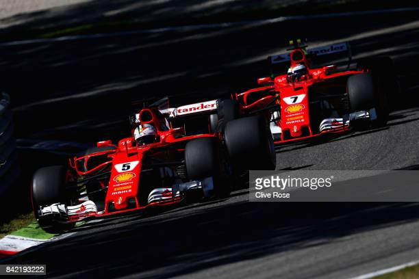 Sebastian Vettel of Germany driving the Scuderia Ferrari SF70H leads Kimi Raikkonen of Finland driving the Scuderia Ferrari SF70H on track during the...