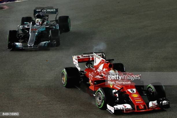 Sebastian Vettel of Germany driving the Scuderia Ferrari SF70H leads Lewis Hamilton of Great Britain driving the Mercedes AMG Petronas F1 Team...