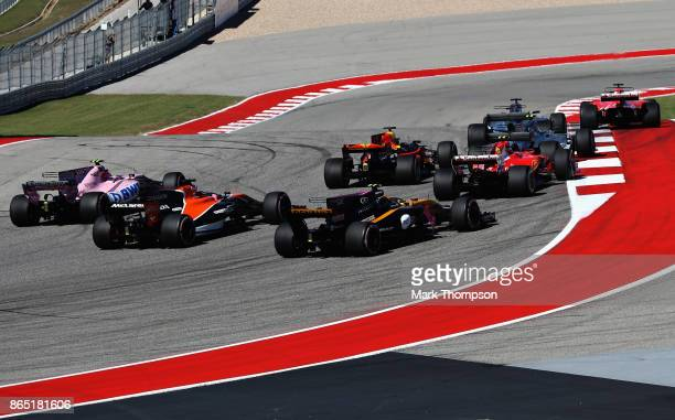 Sebastian Vettel of Germany driving the Scuderia Ferrari SF70H leads the field at the start during the United States Formula One Grand Prix at...