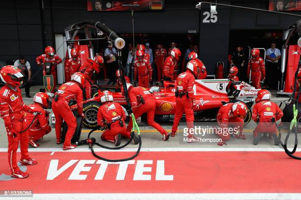 Sebastian Vettel of Germany driving the Scuderia Ferrari SF70H makes a pit stop for new tyres during the Formula One Grand Prix of Great Britain at...