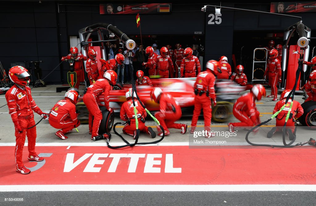 Sebastian Vettel of Germany driving the (5) Scuderia Ferrari SF70H makes a pit stop for new tyres during the Formula One Grand Prix of Great Britain at Silverstone on July 16, 2017 in Northampton, England.