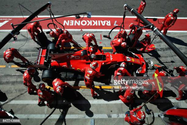 Sebastian Vettel of Germany driving the Scuderia Ferrari SF70H makes a pitstop for new tyres during the Formula One Grand Prix of Italy at Autodromo...