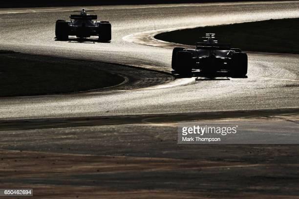 Sebastian Vettel of Germany driving the Scuderia Ferrari SF70H follows Felipe Massa of Brazil driving the Williams Martini Racing Williams FW40...