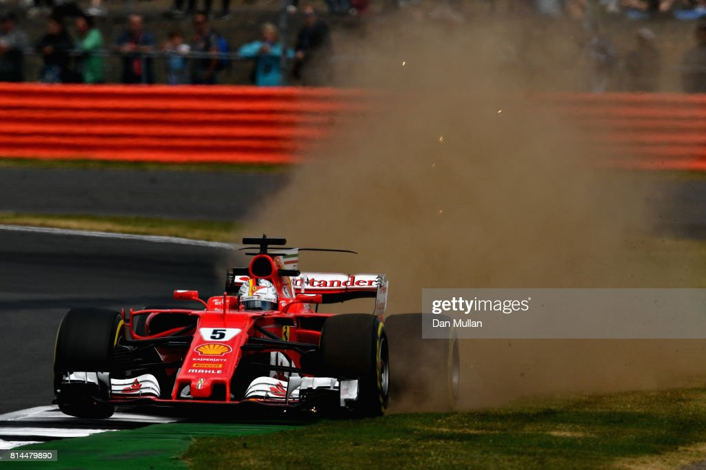 Sebastian Vettel of Germany driving the (5) Scuderia Ferrari SF70H off track during practice for the Formula One Grand Prix of Great Britain at Silverstone on July 14, 2017 in Northampton, England.