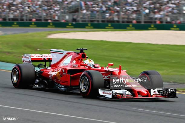 Sebastian Vettel of Germany driving the Scuderia Ferrari SF70H on track during qualifying for the Australian Formula One Grand Prix at Albert Park on...
