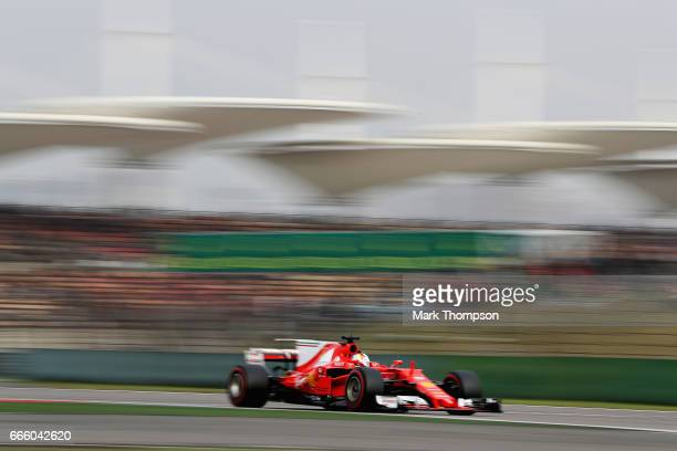 Sebastian Vettel of Germany driving the Scuderia Ferrari SF70H on track during qualifying for the Formula One Grand Prix of China at Shanghai...