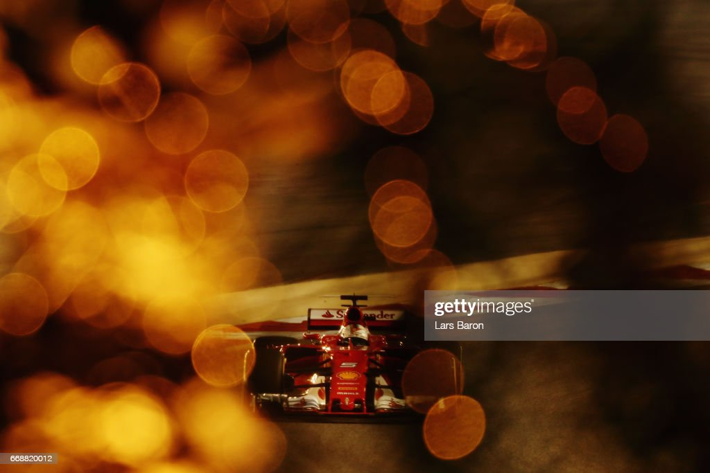 Sebastian Vettel of Germany driving the (5) Scuderia Ferrari SF70H on track during qualifying for the Bahrain Formula One Grand Prix at Bahrain International Circuit on April 15, 2017 in Bahrain, Bahrain.
