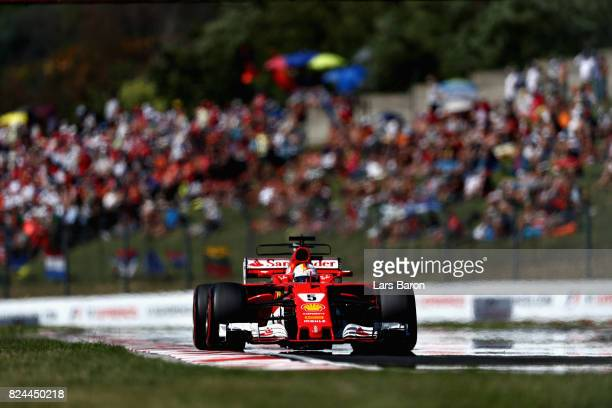 Sebastian Vettel of Germany driving the Scuderia Ferrari SF70H on track during the Formula One Grand Prix of Hungary at Hungaroring on July 30 2017...