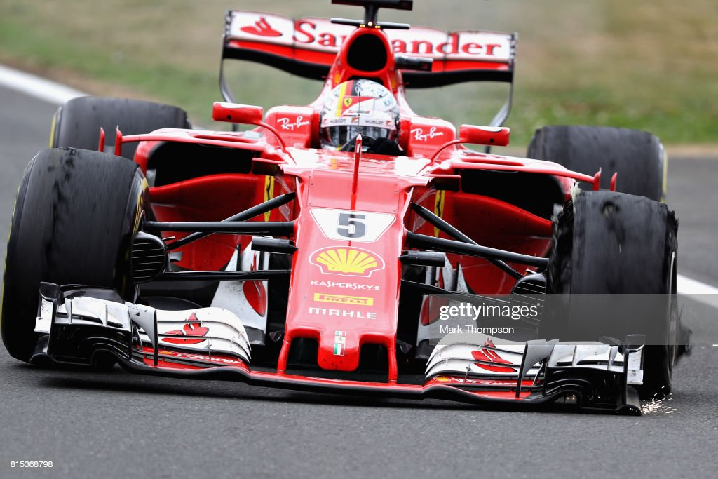 Sebastian Vettel of Germany driving the (5) Scuderia Ferrari SF70H pulls into the pitlane with a broken front left tyre during the Formula One Grand Prix of Great Britain at Silverstone on July 16, 2017 in Northampton, England.