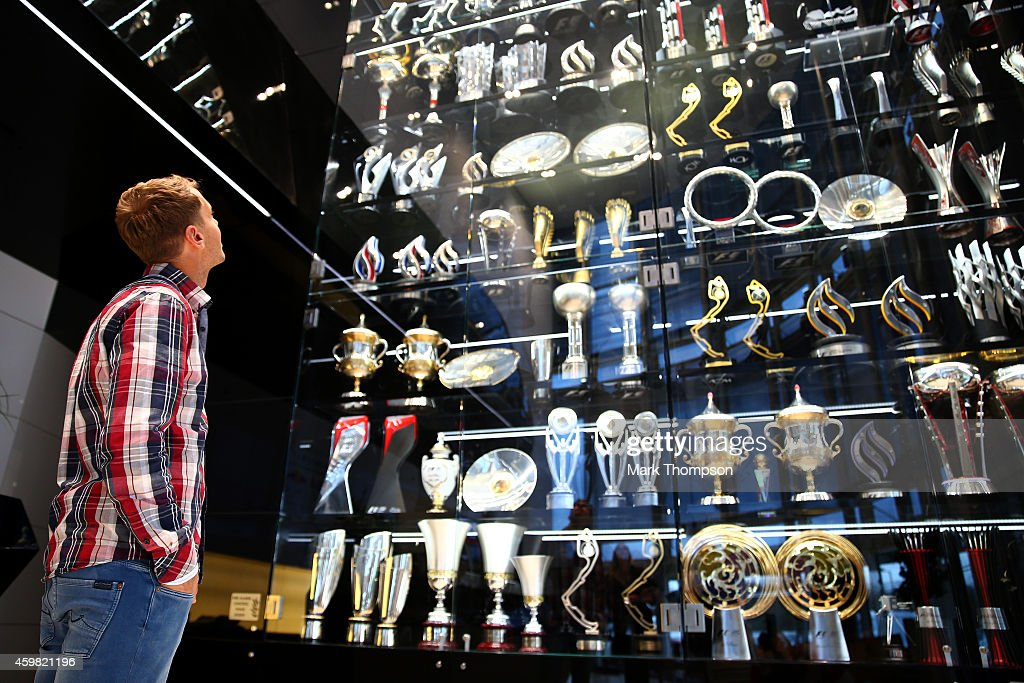 Sebastian Vettel of Germany looks up at the Infiniti red Bull Racing trophy cabinet during a visit to the Red Bull Racing Factory on December 2 2014...