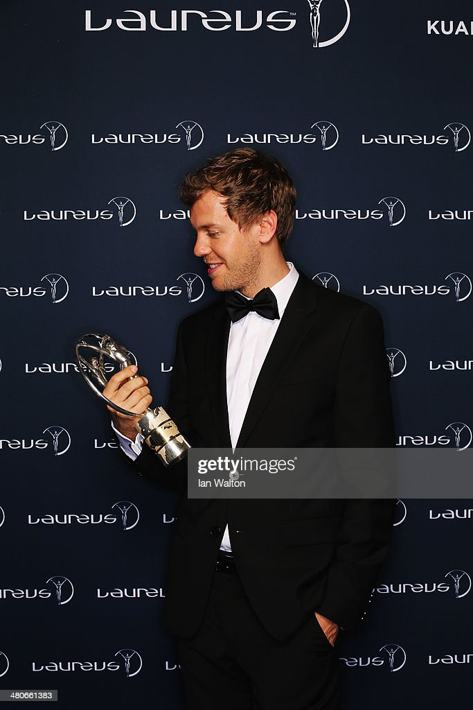 <a gi-track='captionPersonalityLinkClicked' href=/galleries/search?phrase=Sebastian+Vettel&family=editorial&specificpeople=2233605 ng-click='$event.stopPropagation()'>Sebastian Vettel</a> winner of the Laureus World Sportsman of the Year award poses with their trophy during the 2014 Laureus World Sports Awards at the Istana Budaya Theatre on March 26, 2014 in Kuala Lumpur, Malaysia.