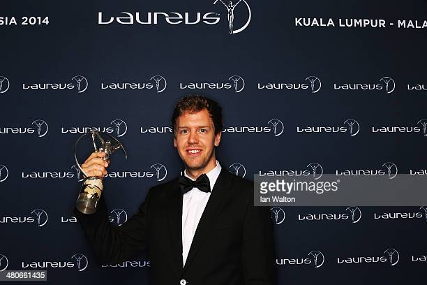 Sebastian Vettel winner of the Laureus World Sportsman of the Year award poses with their trophy during the 2014 Laureus World Sports Awards at the...