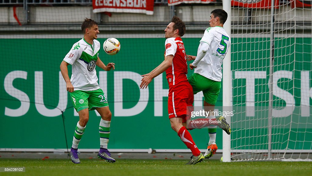 Sebastian Wimmer and <a gi-track='captionPersonalityLinkClicked' href=/galleries/search?phrase=Moritz+Sprenger&family=editorial&specificpeople=7257688 ng-click='$event.stopPropagation()'>Moritz Sprenger</a> of Wolfsburg challenges Markus Ziereis of Regensburg during the 3. Liga Playoff Leg 1 match between VfL Wolfsburg II and Jahn Regensburg at AOK Stadion on May 25, 2016 in Wolfsburg, Germany.