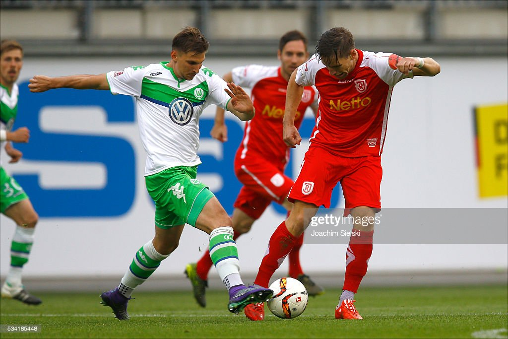 Sebastian Wimmer of Wolfsburg challenges <a gi-track='captionPersonalityLinkClicked' href=/galleries/search?phrase=Kolja+Pusch&family=editorial&specificpeople=5526980 ng-click='$event.stopPropagation()'>Kolja Pusch</a> of Regensburg during the 3. Liga Playoff Leg 1 match between VfL Wolfsburg II and Jahn Regensburg at AOK Stadion on May 25, 2016 in Wolfsburg, Germany.