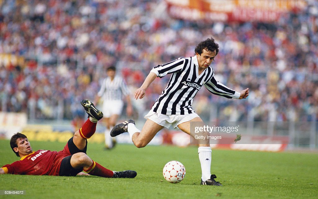 Sebastiano Nela (left) of AS Roma attempts to tackle Michel Platini of Juventus during a Seria A match in the 1985/86 season at the Olympic Stadium in Rome, Italy.