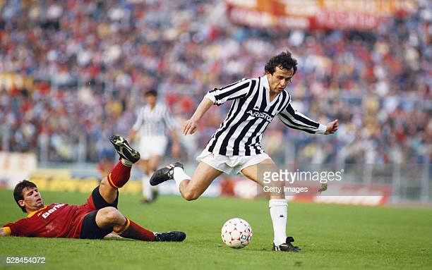 Sebastiano Nela of AS Roma attempts to tackle Michel Platini of Juventus during a Seria A match in the 1985/86 season at the Olympic Stadium in Rome...