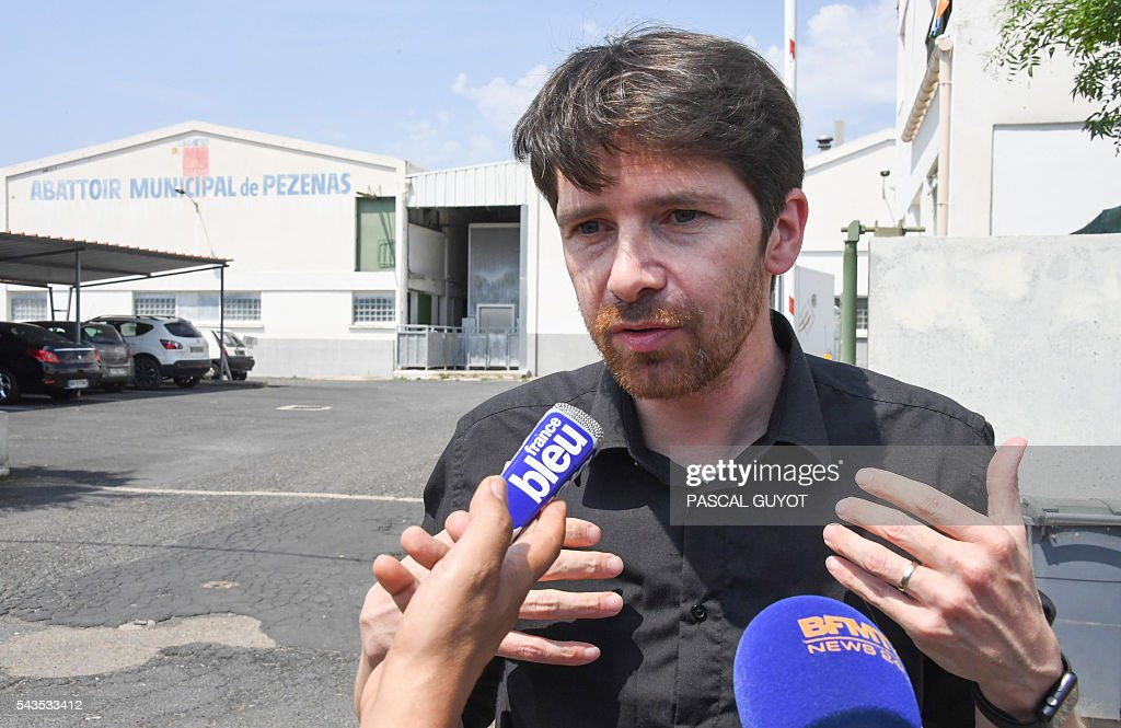 Sebastien Arsac, co-founder of the L214 association speaks to the press in front of the municipal slaughterhouse of Pezenas, on June 29, 2016 after the L214 association released a video denouncing poor animal handling methods in two southern France's slaughterhouses in Pezenas and Puget-Theniers. GUYOT