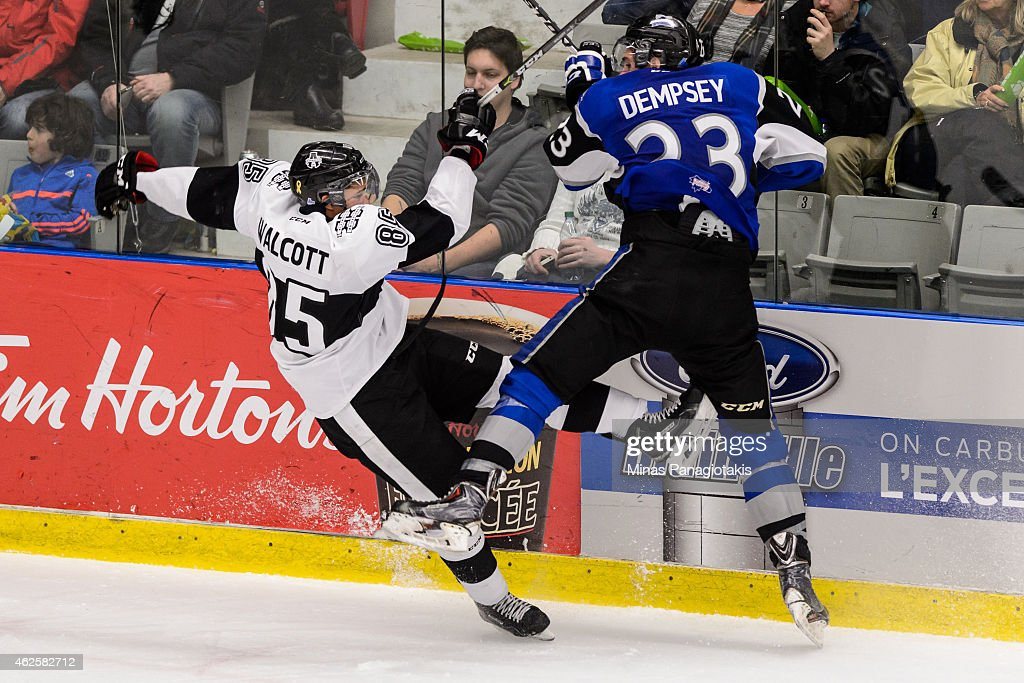 Sebastien Auger #33 of the Saint John Sea Dogs checks Daniel Walcott #85 of the Blainville-Boisbriand Armada during the QMJHL game at the Centre Excellence Rousseau on January 31, 2015 in Blainville-Boisbriand, Quebec, Canada. The Blainville-Boisbriand Armada defeated the Saint John Sea Dogs 4-0.