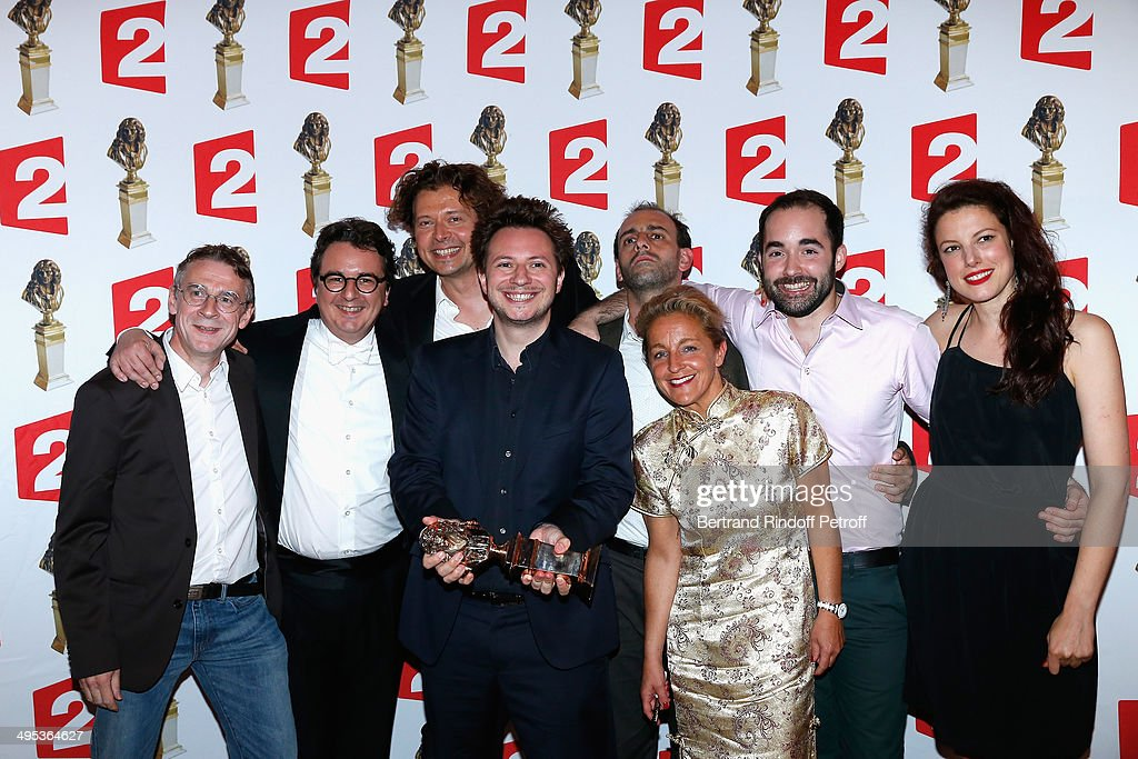 Sebastien Azzopardi (C), winner of the Moliere of Comedy for 'Dernier coup de ciseaux ' poses with his price and the actors of the play after the 26th Molieres Awards Ceremony at Folies Bergere on June 2, 2014 in Paris, France.