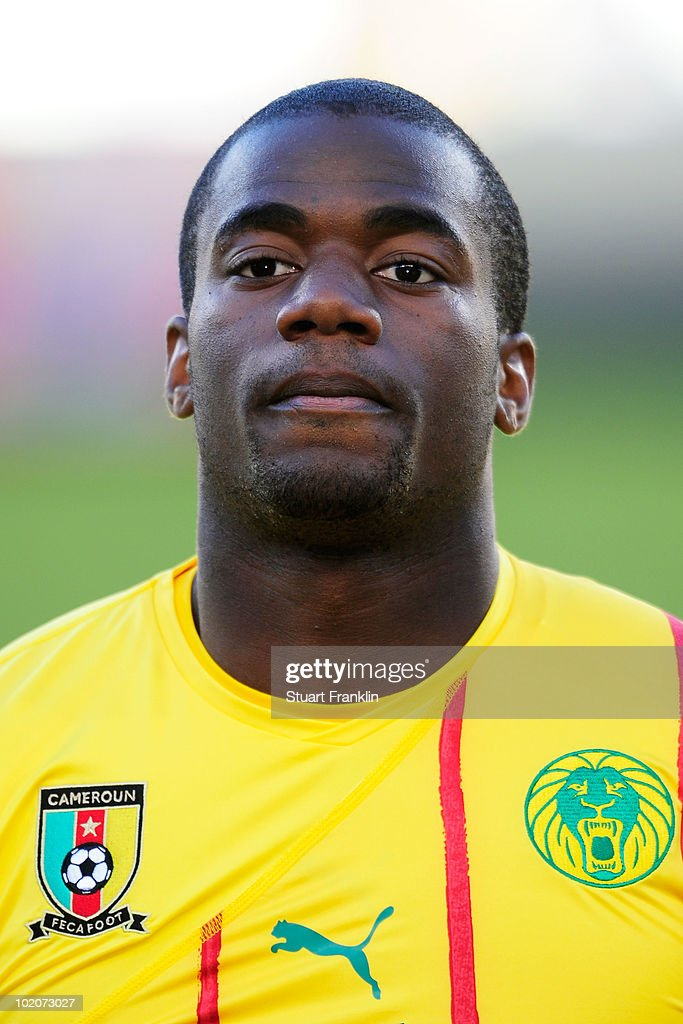 Sebastien Bassong of Cameroon lines up for the national anthems prior to the 2010 FIFA World Cup South Africa Group E match between Japan and...