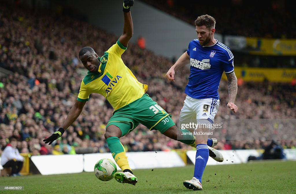 Sebastien Bassong of Norwich city battles with Daryl Murphy of Ioswich Town during the Sky Bet Championship match between Norwich City and Ipswich...