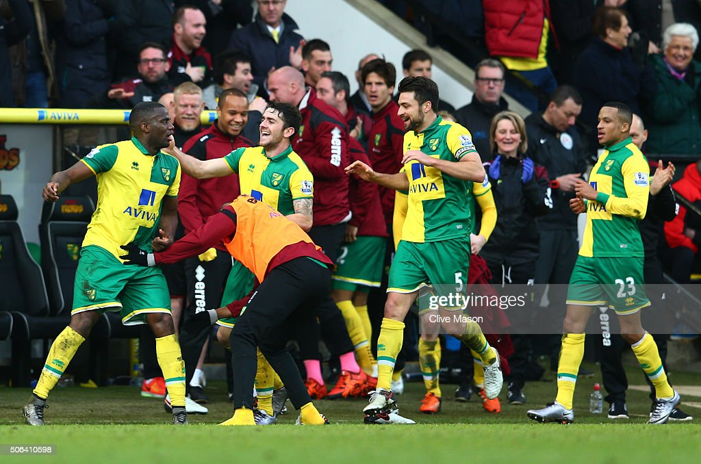 Sebastien Bassong of Norwich City celebrates scoring his team's fourth goal during the Barclays Premier League match between Norwich City and...