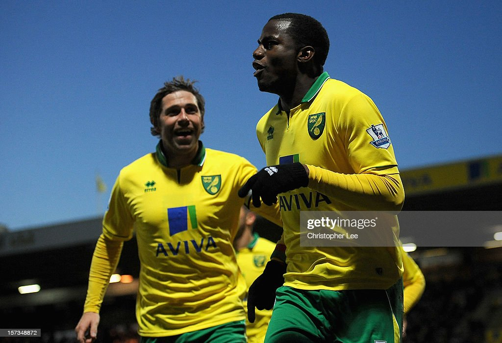 Sebastien Bassong of Norwich City celebrates scoring the opening goal with team mate <a gi-track='captionPersonalityLinkClicked' href=/galleries/search?phrase=Grant+Holt&family=editorial&specificpeople=2091078 ng-click='$event.stopPropagation()'>Grant Holt</a> (L) during the Barclays Premier League match between Norwich City and Sunderland at Carrow Road on December 2, 2012 in Norwich, England.