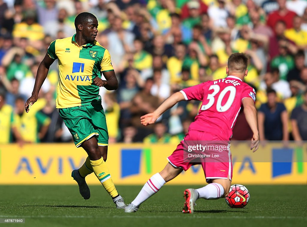 Sebastien Bassong of Norwich City is closed down by Matt Ritchie of Bournemouth during the Barclays Premier League match between Norwich City and AFC...