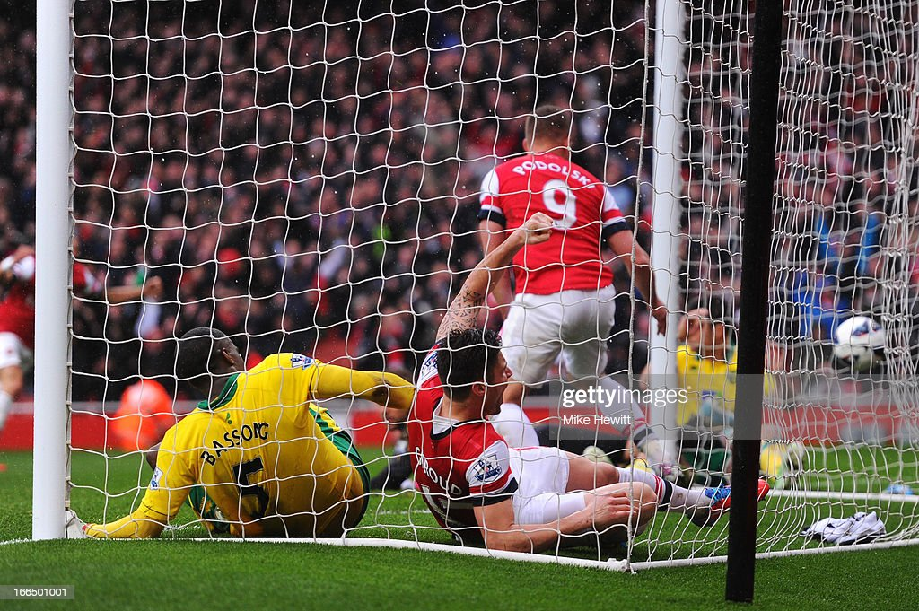 Sebastien Bassong of Norwich City scores on his own goal during the Barclays Premier League match between Arsenal and Norwich City at Emirates...