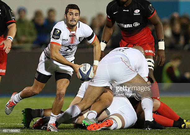 Sebastien Bezy of Toulouse passes the ball during the European Rugby Champions Cup match between Saracens and Toulouse at Allianz Park on November 14...