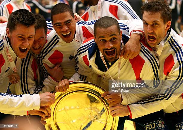 Sebastien Bosquet Guillaume Joli Daniel Narcisse Didier Dinart and Guillaume Gille of France celebrate with the trophy after winning the Men's...