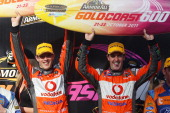 Sebastien Bourdais and Jamie Whincup of Team Vodafone Holden celebrate winning race 1 during the V8 Supercars Gold Coast 600 at the Gold Coast Street...