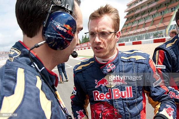 Sebastien Bourdais of France and Scuderia Toro Rosso is seen on the grid before the German Formula One Grand Prix at Nurburgring on July 12 2009 in...
