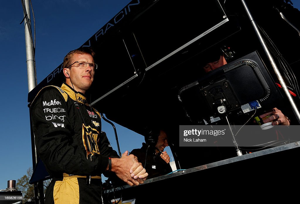 Sebastien Bourdais of France, driver of the #7 Dragon Racing Chevrolet, stands on pit wall prior to practice for the Honda Indy Grand Prix of Alabama at Barber Motorsports Park on April 6, 2013 in Birmingham, Alabama.