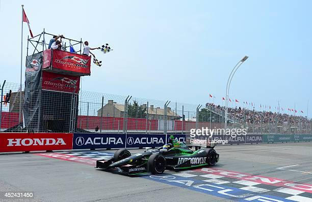 Sebastien Bourdais of France driver of the KVSH Racing Dallara Chevrolet crosses the finish line to win race 1 of the Verizon IndyCar Series Honda...