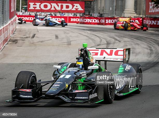TORONTO ON JULY 20 Sebastien Bourdais pumps his fist in the air after crossing the finish line to wins the first of two Indy Car races Bourdais lead...