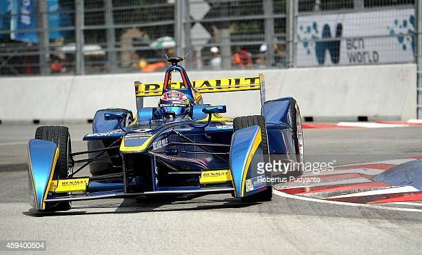 Sebastien Buemi of Switzerland and eDamsRenault Formula E Team drives during the FIA Formula E Putrajaya ePrix Championship race on November 22 2014...