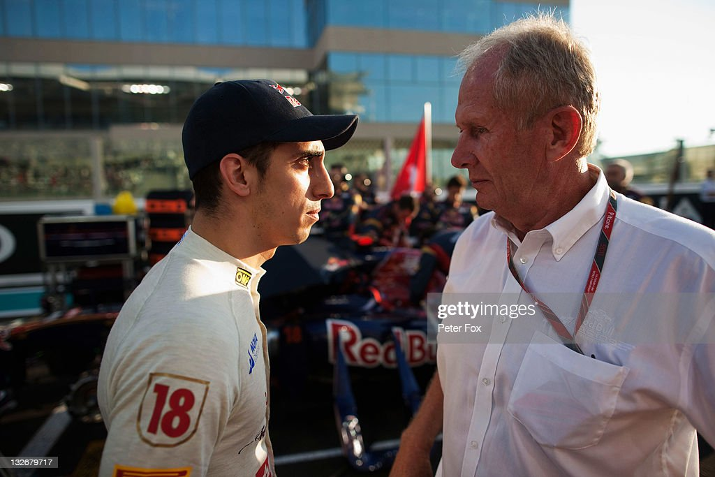 Sebastien Buemi of Switzerland and Scuderia Toro Rosso talks with Dr Helmut Marko before the Abu Dhabi Formula One Grand Prix at the Yas Marina Circuit on November 13, 2011 in Abu Dhabi, United Arab Emirates.