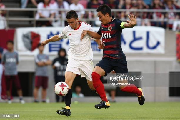 Sebastien Corchia of Sevilla and Gen Shoji of Kashima Antlers compete for the ball during the preseason friendly match between Kashima Antlers and...