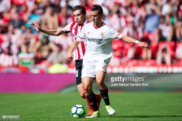 Sebastien Corchia of Sevilla FC competes for the ball with Inigo Cordoba of Athletic Club during the La Liga match between Athletic Club Bilbao and...