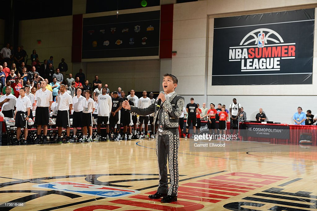 Sebastien DE LA CRUZ signs the national anthem prior to the game where The Atlanta Hawks versus the San Antonio Spurs during NBA Summer League on July 15, 2013 at the Cox Pavilion in Las Vegas, Nevada.