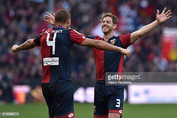 Sebastien De Maio and Cristian Ansaldi of Genoa CFC celebrate victory at the end of the Serie A match between Genoa CFC and Torino FC at Stadio Luigi...