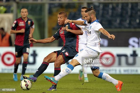 Sebastien De Maio of Genoa CFC battles for the ball with Lorenzo Tonelli of Empoli FC during the Serie A match between Genoa CFC and Empoli FC at...