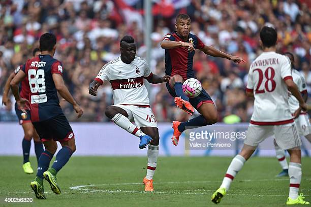 Sebastien De Maio of Genoa CFC controls the ball against Mario Balotelli of AC Milan during the Serie A match between Genoa CFC and AC Milan at...