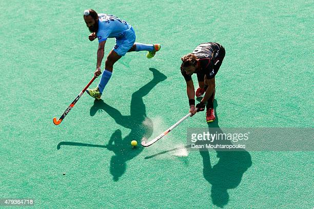 Sebastien Dockier of Belgium and Jasjit Singh Kular of India battle for the ball during the Fintro Hockey World League SemiFinal match between India...