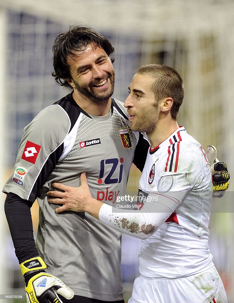 Sebastien Frey of Genoa CFC (L) and Mathieu Flamini of AC Milan during the Serie A match between Genoa CFC and AC Milan at Stadio Luigi Ferraris on March 8, 2013 in Genoa, Italy.
