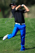 Sebastien Gros of France has to use all his strength from the deep rough for his second shot at the par 4 fifth hole during the first round of the...