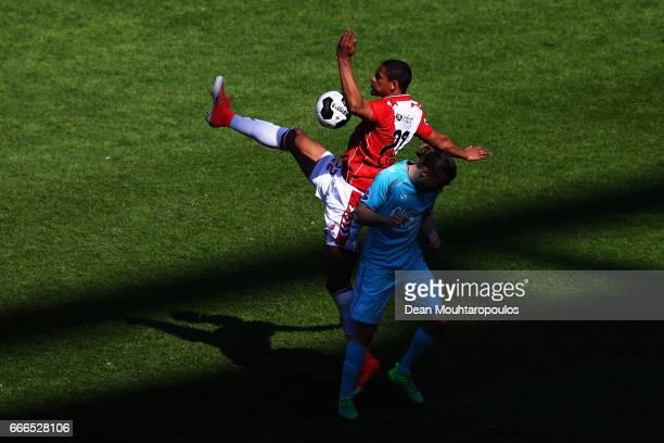 Sebastien Haller of FC Twente battles for the ball with Jeroen van der Lely of FC Utrecht during the Dutch Eredivisie match between FC Utrecht and FC...